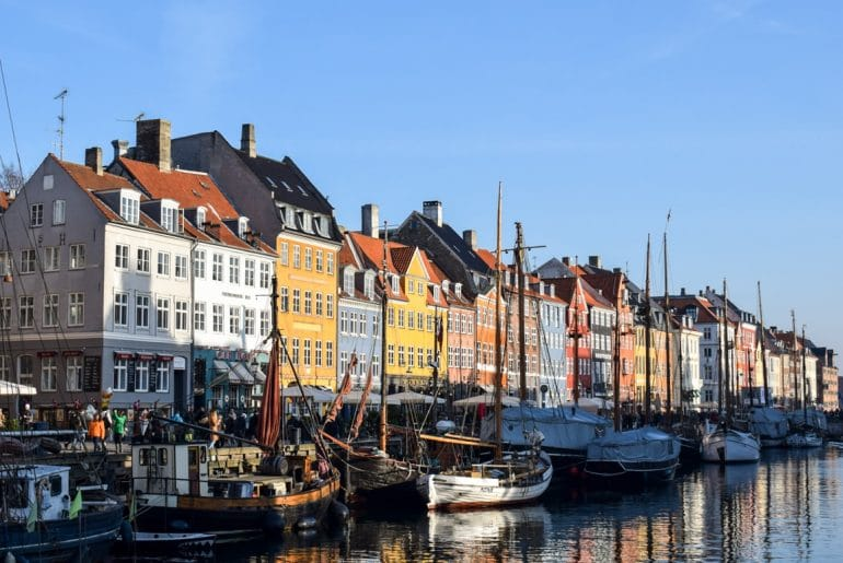 colourful harbour houses with boats floating must see places in europe in winter copenhagen denmark