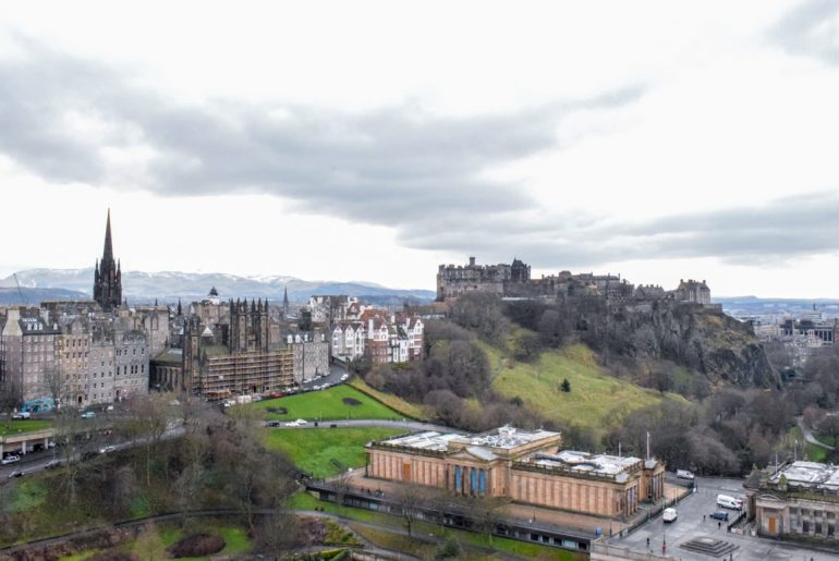 castle and green gardens from above in edinburgh must see places in europe in winter