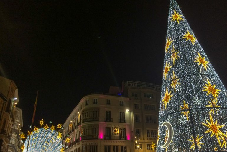 wire christmas tree with lights at night in spanish square must see places in europe in winter malaga spain