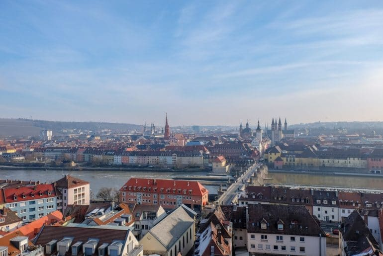 old town german rooftops and river with bridge wurzburg must see places in europe in winter