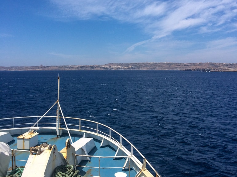 blue ocean with tip of blue ferry and blue sky things to do in gozo