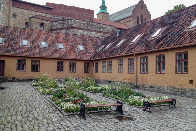colourful courtyard buildings and flowers things to do in oslo norway
