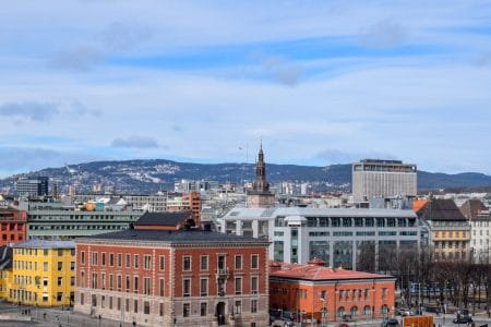 colourful buildings and blue sky sentrum things to do in oslo norway