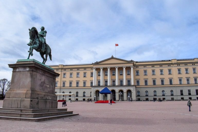yellow palace with statue in front things to do in oslo norway