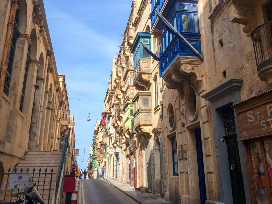 colourful window shutters and narrow stone streets things to do in valletta malta