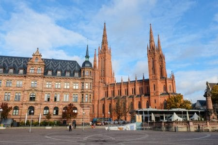 red brick church and main square with blue sky things to do in wiesbaden germany