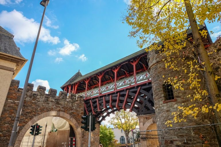 wooden archway bridge and stone arch entrance things to do in wiesbaden