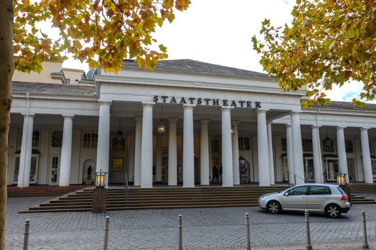 white pillars to front building entrance with car things to do in wiesbaden