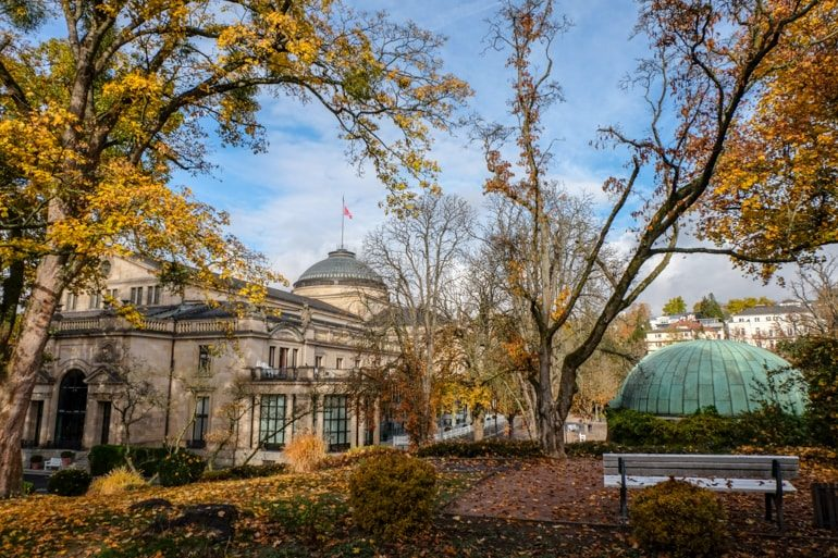 theatre building through autumn trees things to do in wiesbaden