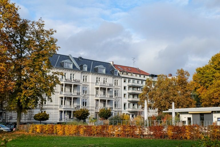 white buildings with autumn leaves on trees in front things to do in wiesbaden
