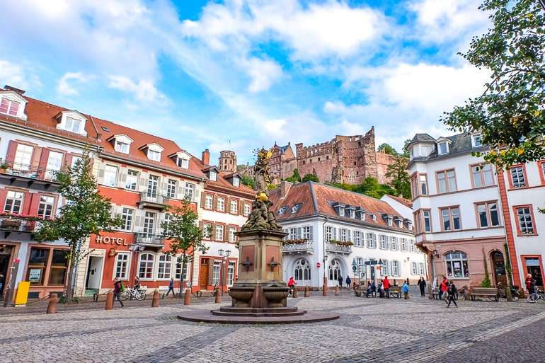 castle on hill above colourful old town heidelberg beautiful places in germany
