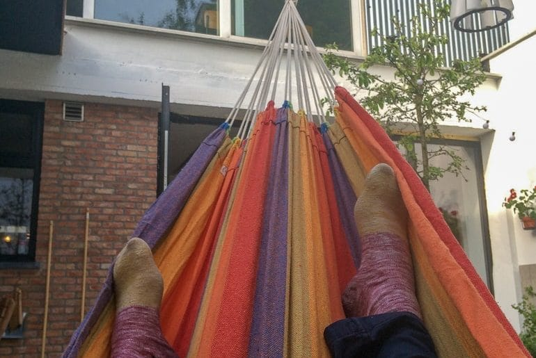 feet in colourful hammock european hostels antwerp belgium