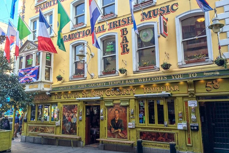 yellow building with flags outside european hostels dublin ireland
