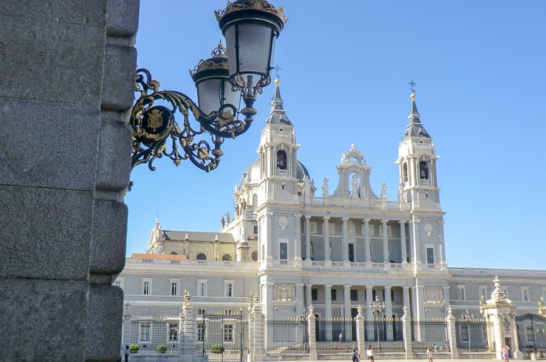 white building with light post european hostels madrid spain
