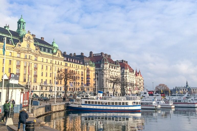 colourful old buildings on waterfront with boats european hostels stockholm sweden