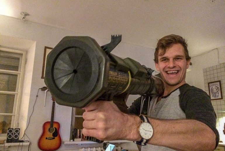 man with bazooka in kitchen european hostels vilnius lithuania