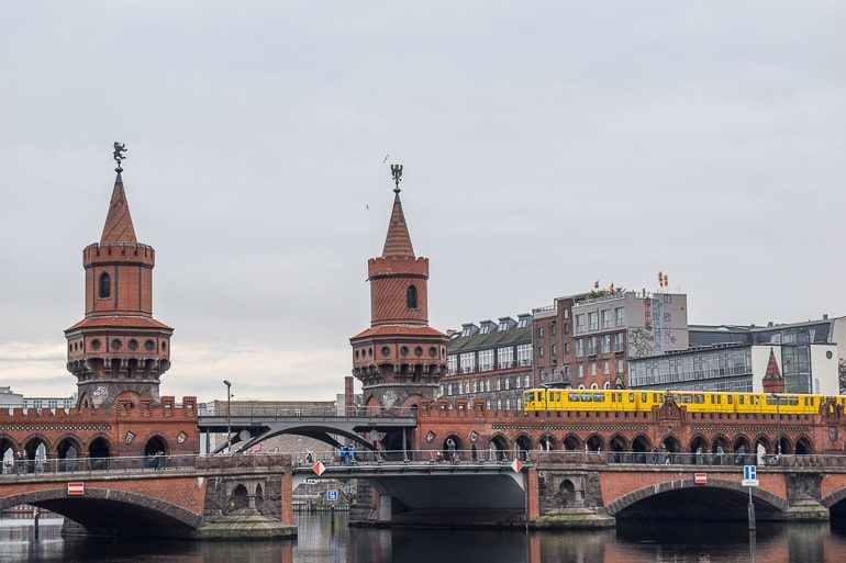 red bridge with yellow train on it berlin hostels in germany