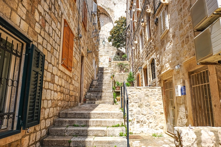 stone stairs to old town walls with doors where to stay in Dubrovnik apartments