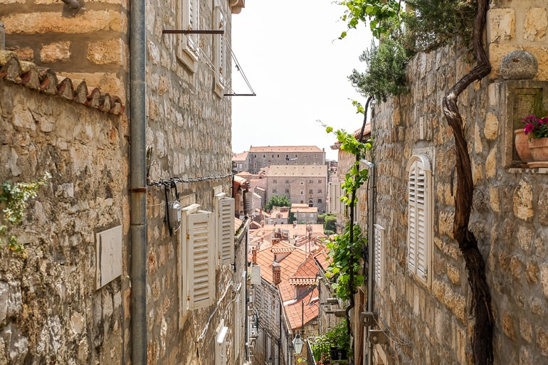 narrow stone alleyway looking over dubrovnik old town where to stay in dubrovnik