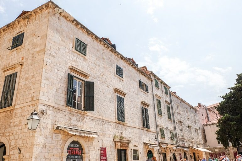stone building in croatia with dark shutters where to stay in dubrovnik
