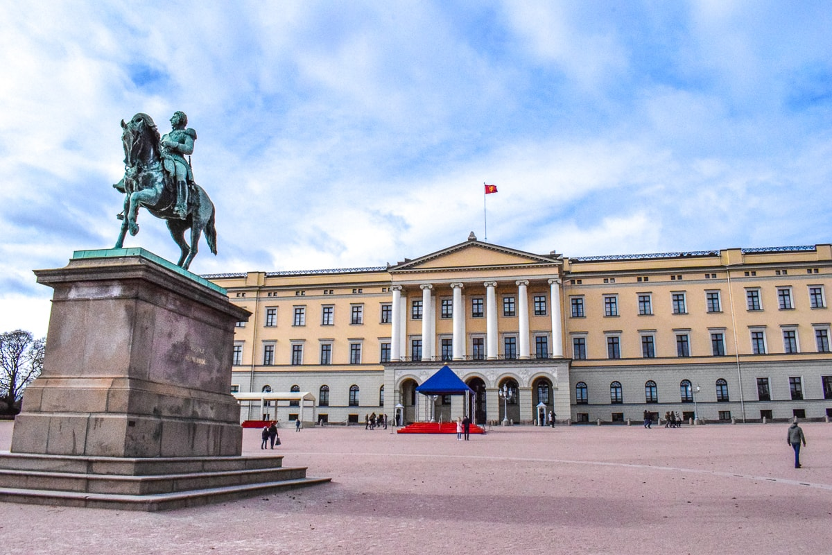 yellow palace building with horse statue where to stay in oslo