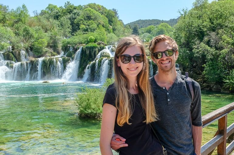 couple in front of waterfall krka national park travelling to europe for the first time