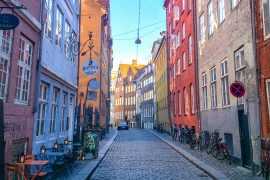 colourful houses with cobble stone street one day in copenhagen
