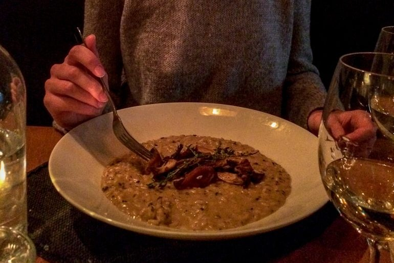bowl of risotto on table with wine glasses barcola montreal