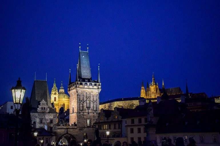 castle tower at night one day in prague sunrise