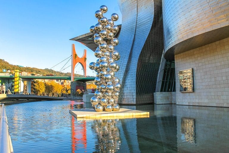 steel balls in sculpture over water things to do in bilbao spain Guggenheim museum