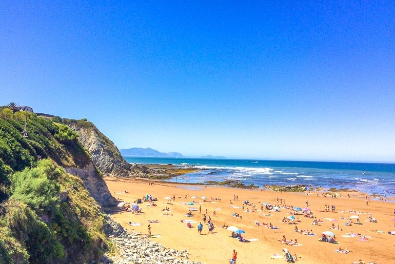 beach with blue sky and yellow sand things to do in bilbao spain