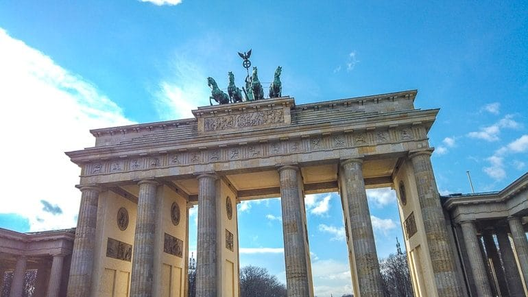 stone gate with pillars and statue on top berlin brandenburg attractions