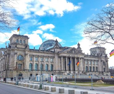 old building with glass dome in top berlin attractions