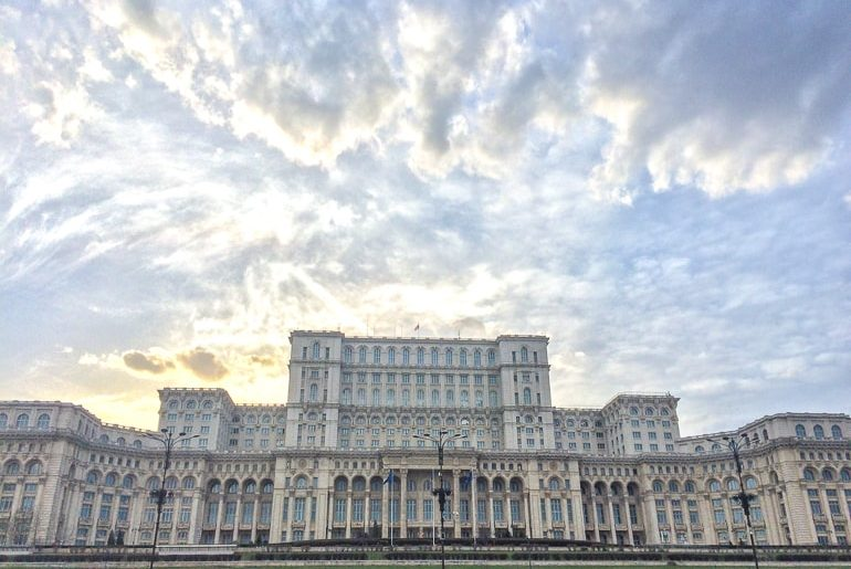 large palace building with cloudy sky cheap cities Bucharest
