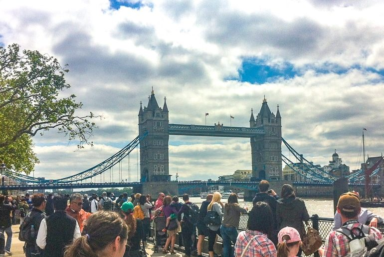 bridge over river with crowd in front tower bridge
