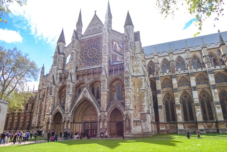 historic church entrance with green lawn westminster abbey london