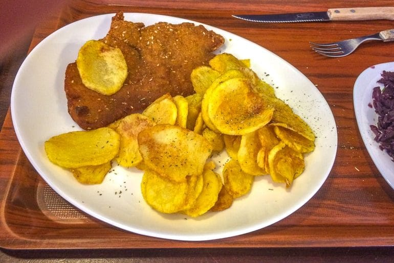 schnitzel and potatoes on white platter with cutlery 3 days in budapest