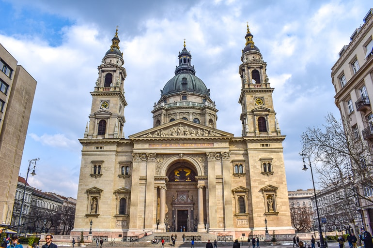 large church on with tall domes in open square budapest