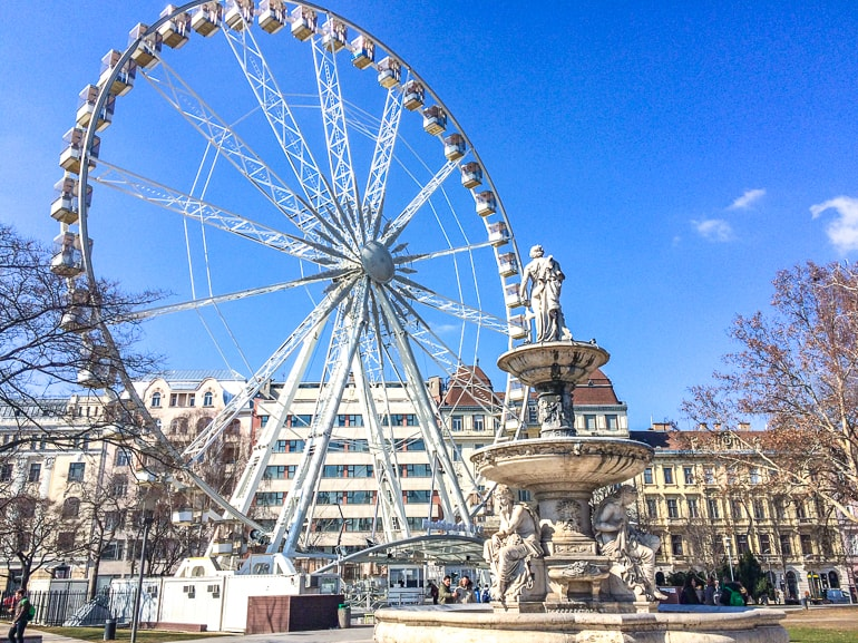 ferris wheel in park with fountain budapest things to do and see