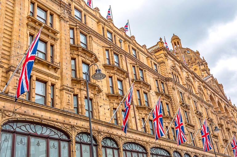 large department store exterior with British flags hanging harrods knightsbridge