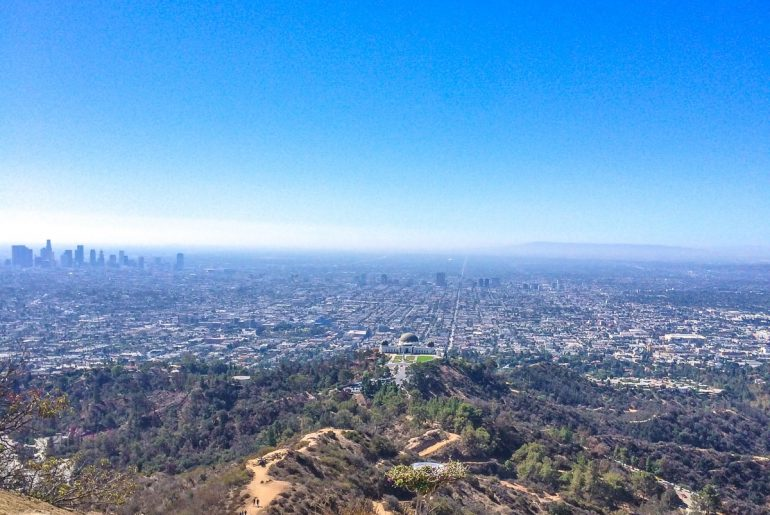 city views from up on mountain with blue sky best places to visit in los angeles griffith