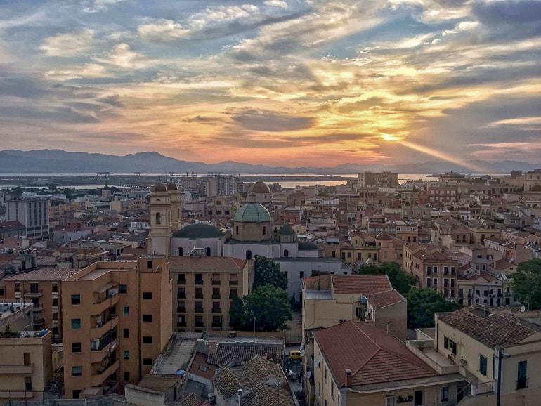 italian town with setting sun in distance cagliari italy
