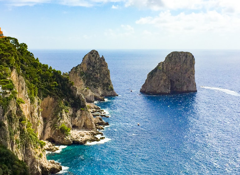 blue sea with rock formations sticking out in capri italy