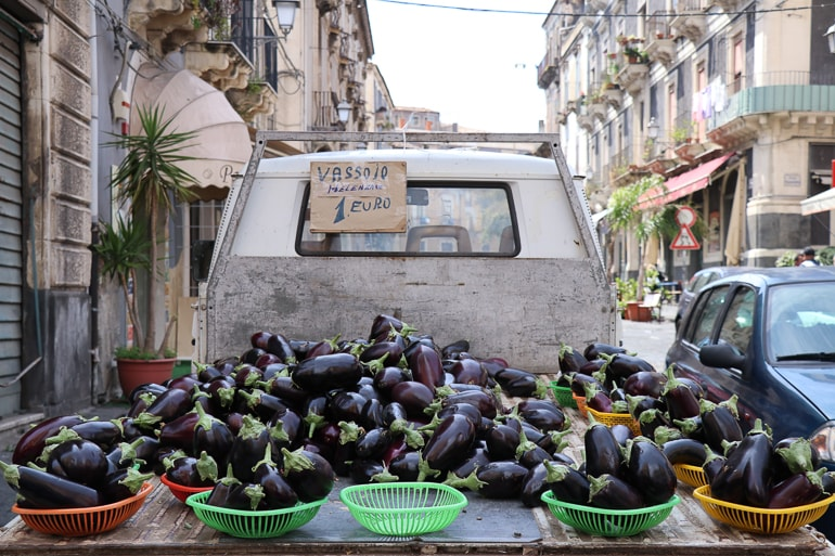 eggplants in bowls on back of market truck catania sicily