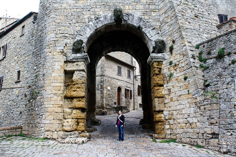 old stone archway in old town italy
