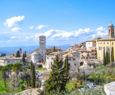 italian town on hillside under the sunshine italy attractions asissi