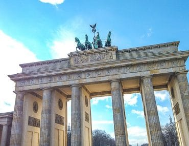 stone brandenburg gate way one day in berlin