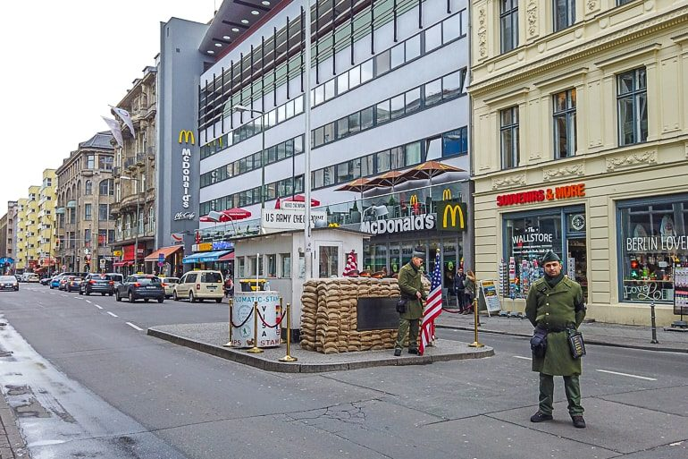 soldiers at road block in middle of city street checkpoint charlie