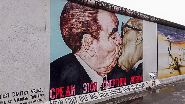 painting of men kissing on berlin wall east side gallery