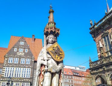 stone statue in german town square with blue sky things to do in bremen